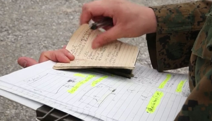 Marine Reservist Takes Notes During CBRN Training Course