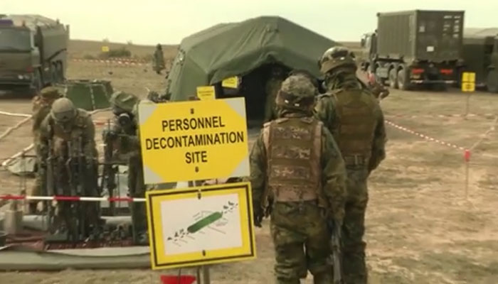 CBRN Troops In Line for Decontamination