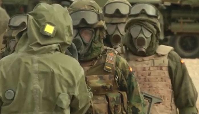 Spanish CBRN Troops Awaiting Decontamination