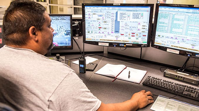A Control Room operator monitors the initial light-off process of the first Thermal Oxidizer (TOX) unit, part of the Blue Grass Chemical Agent-Destruction Pilot Plant's pollution abatement system. During operations, the TOX units will thermally cleanse the gases leaving the Metal Parts Treaters.