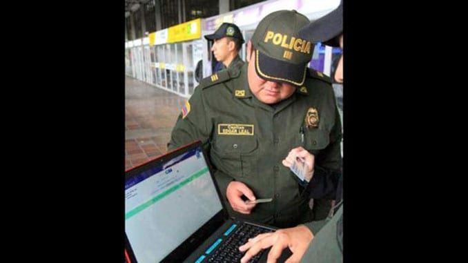 Officers screening passengers in INTERPOL's Mind/Find database