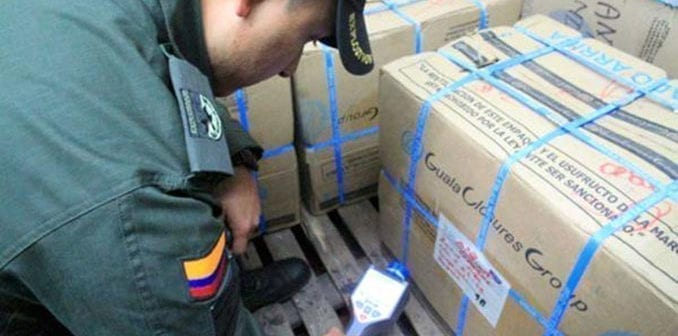 Officers screening cargo for nuclear or other radioactive material using a mobile detector