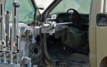 EOD Tech Manipulates Robot to Disable Bomb Threat in Vehicle