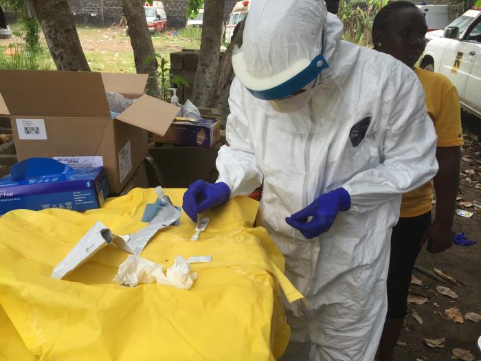 Epidemiologist Conducts Rapid Ebolavirus Diagnostic Assay