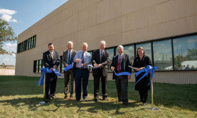 NIST Team and local representatives stand in front of new Radiation Physics Lab Building