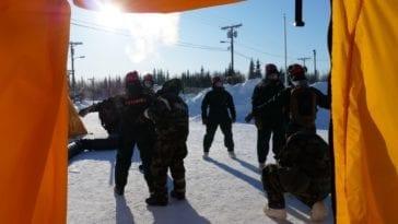 Guardsmen in freezing sunny backdrop being decontaminated